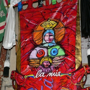 What does the word Palio mean? And who are the artists who design the Palio banner?